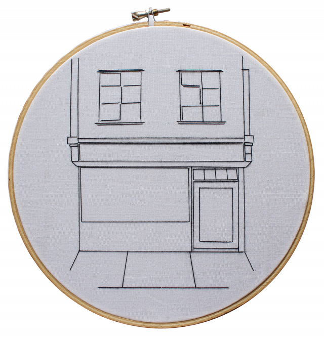 Embroidery of an empty storefront.