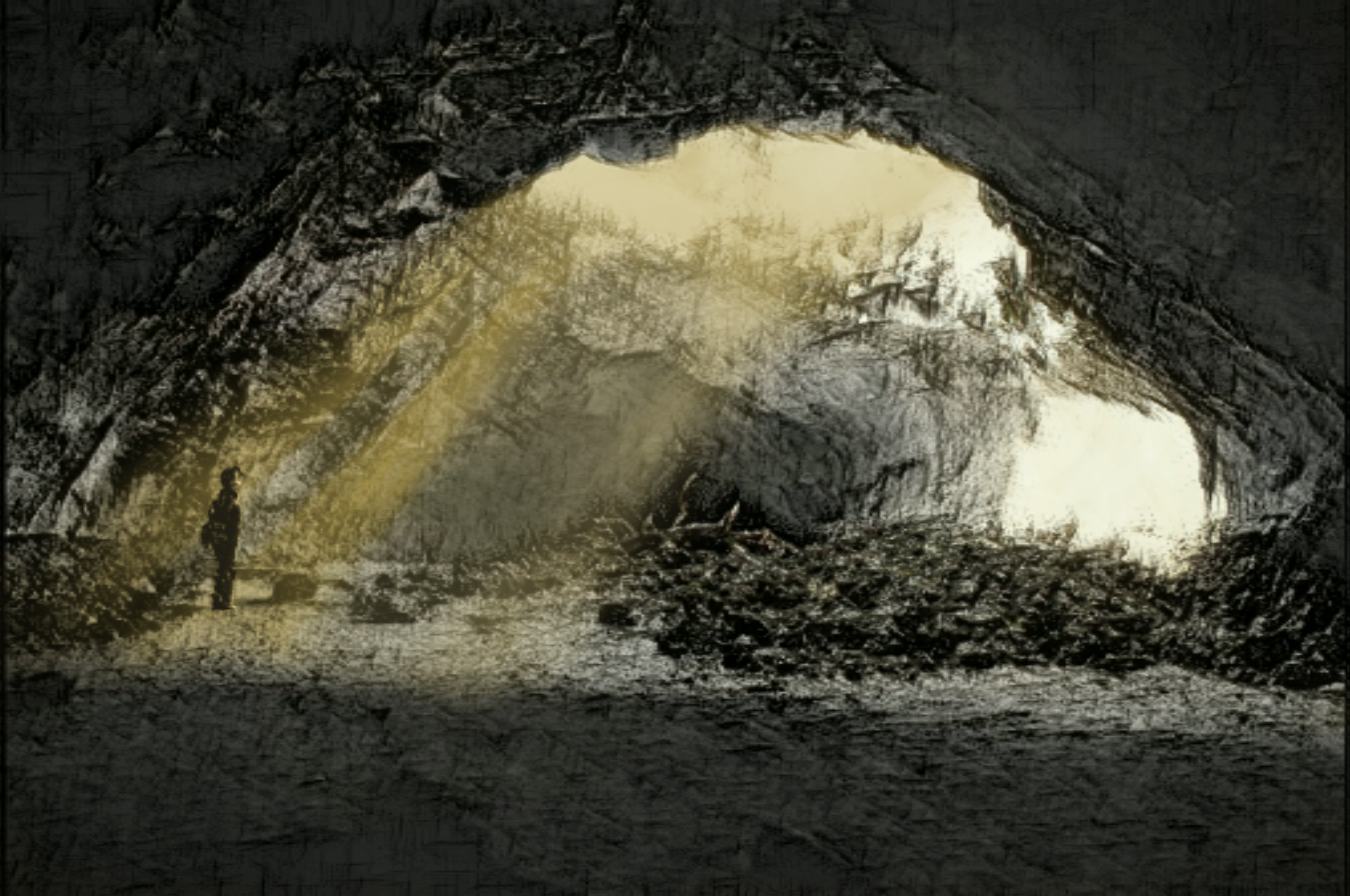 man stares at hole in cave tunnel